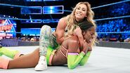 Carmella holding on Naomi