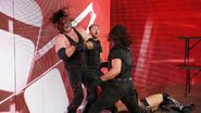 Ambrose and Rollins attacking Kane