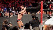 Ambrose dives onto Cesaro