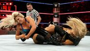 Charlotte and Natalya grapple for position