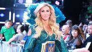 Charlotte is welcomed into the arena by the WWE Universe
