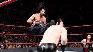 Rollins dropkick Sheamus