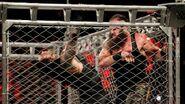 Strowman fighting off Reigns
