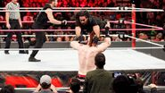Rollins suicude dive onto Sheamus