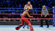 Sami-Zayn twisting Shinsuke-Nakamura wrist