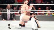 Neville fighting Tozawa at SummerSlam 2017