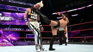 Neville with a kick to Enzo