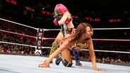 Asuka traps Emma in a ankle lock