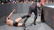 Balor push Kane to the steel step