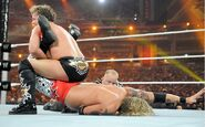 Jericho putting Edge in submission