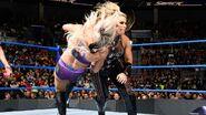 Natalya clothesline Charlotte