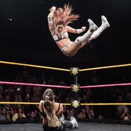 Sane delivered an elbow drop on Aliyah