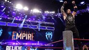 Roman-Reigns arms up