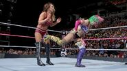 Asuka strike a back kick right to Emma