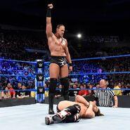 Cass stands tall over Daniel Bryan