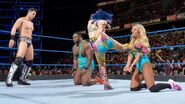 Asuka and Miz continuingly kicking Carmella and Big E