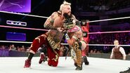 Amore putting Kalisto in a headlock