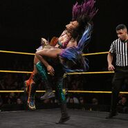 Peyton-Royce knee right into Ember-Moon lower body