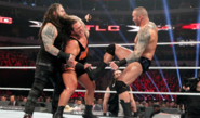 Wyatt holding Rhyno and While Orton kicked