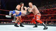 Slater and Rhyno double clothesline Dawson
