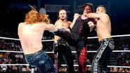 Kane kick Heath with Drew and Mahal