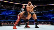 Rusev muscles his way out of Nakamura's early array of holds and submissions