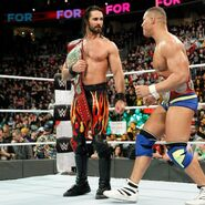 Seth Rollins strategize before their daunting challenge