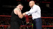 Triple H giving Owens the Universal Champion