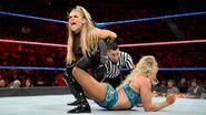 Natalya locks Charlotte in the excruciating sharpshooter