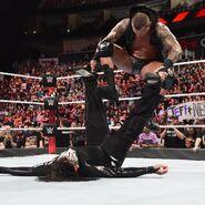 Orton stomps between Jeff Hardy's legs