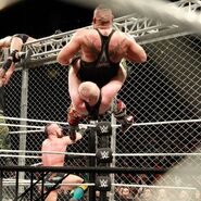 Alexander-Wolfe strikes with a German Suplex from the top rope sending himself and Rezar through the table