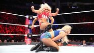 Charlotte Flair kicked from the side by Alexa Bliss