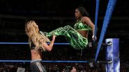Naomi pushing Carmella