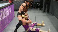 Neville tries rippin Metalik mask