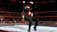 Reigns tosses Joe across the ring
