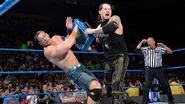 Corbin hits Cena with the briefcase