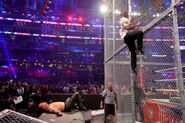 Undertaker down while Shane-McMahon climb up