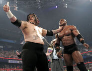 Umaga choking Lashley