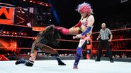 Asuka delivers a kick behind Fox