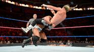 Roode deliver a massive spinebuster to Dolph-Ziggler