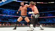 Roode throw a punch to Ziggler