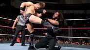 Miz kicking Rollins