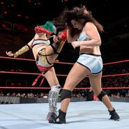 Asuka superkick into her opponent