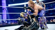 Tyler Breeze facing Goldust