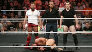 Drew-McIntyre beaten down by Fish O'Reilly Cole