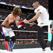 Shane-McMahon kick right to Styles