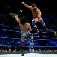 Roode jumps with a clothesline onto Mahal