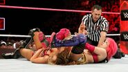 Asuka putting Emma in submission hold