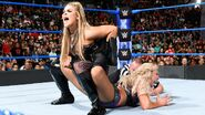Natalya traps her longtime nemesis in the painful Sharpshooter