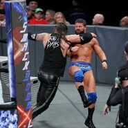 Roode into the clothesline by Corbin